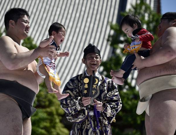 In Japan, letting a sumo wrestler make your baby cry is said to bring good health as well as warding off evil spirits.