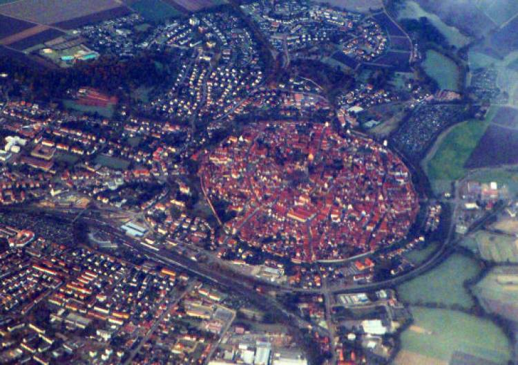 The town of Nördlingen, Germany, was built inside an old crater from a meteor that once crashed into the countryside. Residents have incorporated parts of the meteor into their town, including the church - which is encrusted with meteorites and microscopic diamonds.