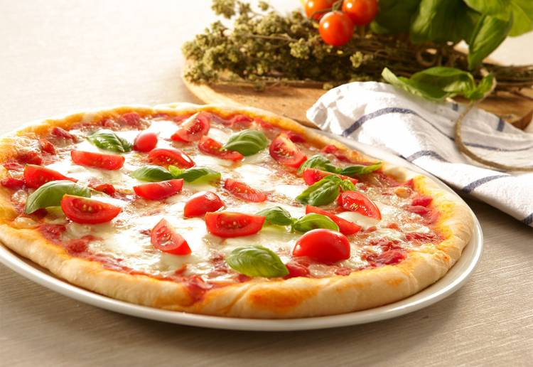 Americans eat approximately 100 acres of pizza a day or about 350 slices per second. There are approximately 61,269 pizzerias in the United States. Each person in America eats about 46 pizza slices a year.